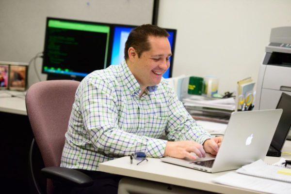 Alumni Ambassador working at his laptop