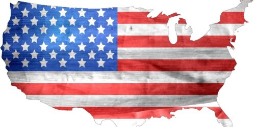 American Flag over the outline of the 48 lower states