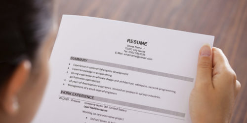 Young businesswoman reading a resume